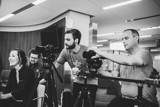 black and white photo of videographers